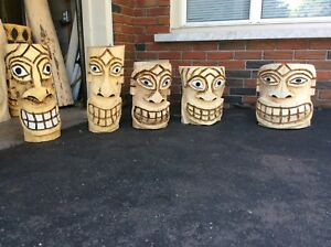 Wall hanging Tiki carvings