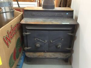 Large Cast Iron Wood Burning Stove w Insulated Pipes