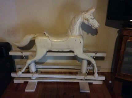 Vintage rocking horse works well sturdy construction