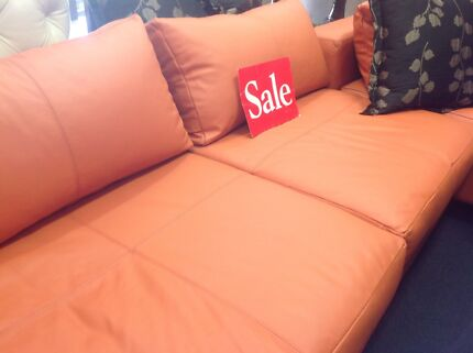 Orange leather sofa plus other orange accessories