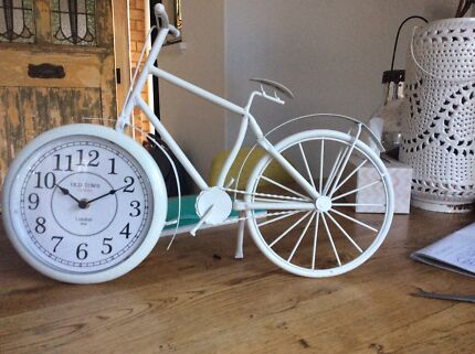 Ornamental retro bicycle with clock