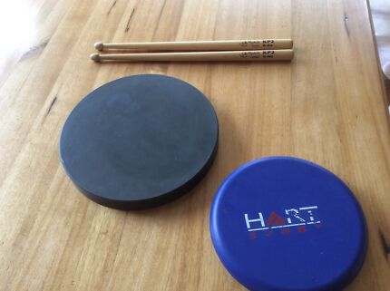 Drumming practice pad and sticks
