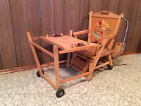 Antique wooded highchair/playtable combination