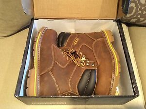 New  size 10 steel toe hi top work boots