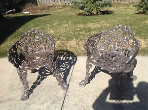 2 Vintage cast Iron chairs from Hauser Furniture