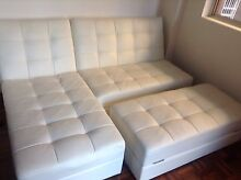 Like new white leather sofa that completely folds down into a bed Rushcutters Bay Inner Sydney Preview
