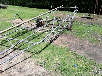 Farm irrigation pipe trailer