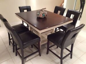 Counter height table and 6 dark brown leather chairs