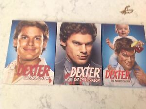 Dexter seasons 2, 3, and 4 still in wrappers