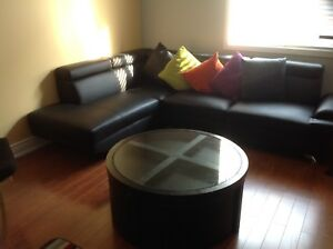 LEATHER SECTIONAL SOFA priced to sell with 4 STOOL GLASS TABLE