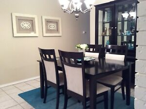 Black and white dining set including china cabinet