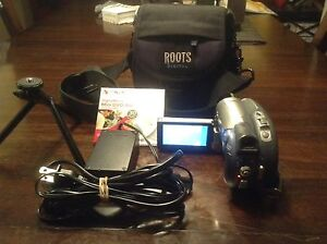 Camcorder Canon DC210, bag, tripod, cable, and 1 new DVD