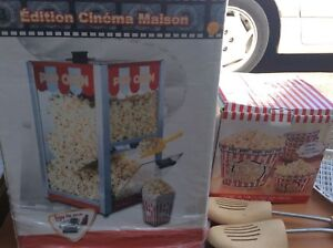 Popcorn machine with 4 ceramic bowls $60