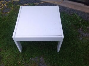 White table. Top pops out. About 2 x 2 feet