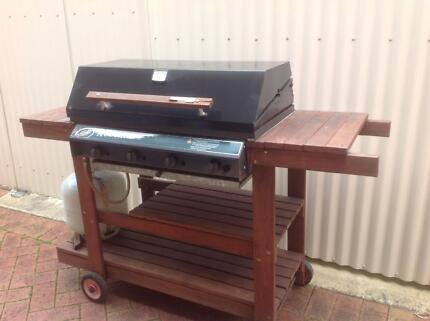 4 burner gas BBQ in good worki with vinyl cover on timber trolley Clarendon Morphett Vale Area Preview