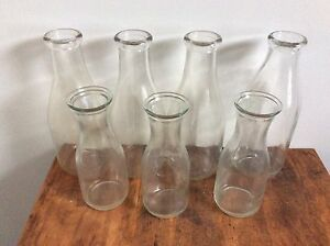Old milk jugs 12 large and three small ones left
