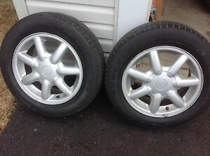"""14"""" VW  alloy rims and tires"""