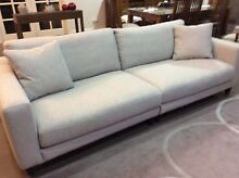 Plush four seater material sofa Geelong Geelong City Preview