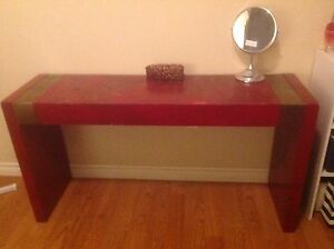 Red sofa table with gold accent