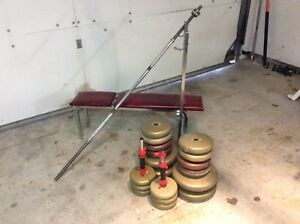 Adjustable bench with bars and 210 lbs