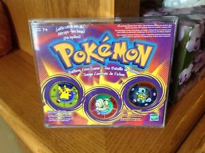 Pokemon battling coin game.  About 12 of these packages