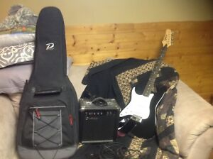Electric guitar, amp and case for sale Left Handed