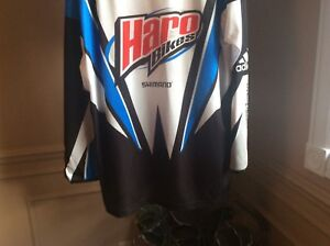 Assorted great condition BMX race jerseys.