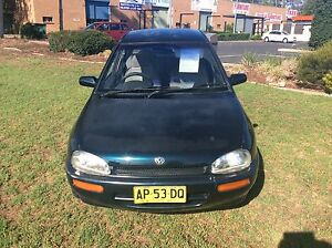 1994 Mazda 121 Sedan 4 Cyl AUTO REGO 29/10/17 Reliable Economical Woodbine Campbelltown Area Preview