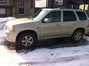 I am selling my 2005 Mazda Tribute  V6,