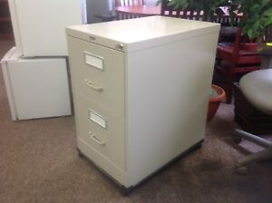 Two drawer filling cabinet.