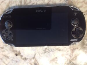 Sony PS Vita Oled mint no scratches w carry case.