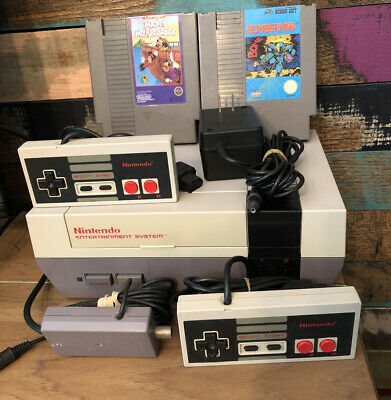 Nintendo NES System Console With 2 Controllers, Bomber man, Mickey Mouscapade