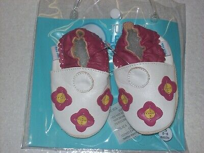 Brand new Soft leather baby shoes  flowers white colour 12 to 18 months