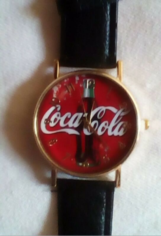 BRAND NEW...Coca-Cola Watch, black leather band, gold tone housing