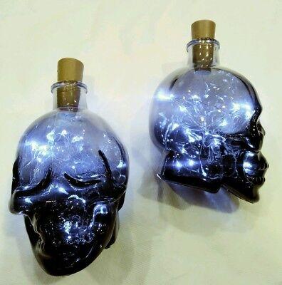 Set of 2 black gradient color glass Halloween Skull Jars with fairy lights. (Glass Jar Lights Halloween)