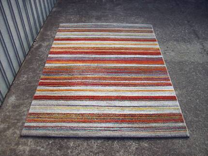 Modern colourful rug 120 cm by 170 cm top quality as new