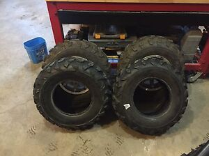 Like new Stock rims x2 and 4 like new stock tires