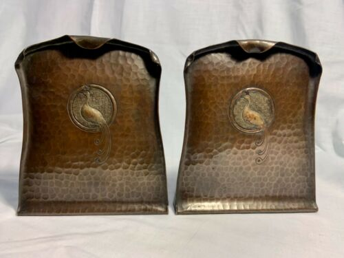 CRAFTSMAN STUDIOS HAMMERED COPPER BOOKENDS WITH A PEACOCK IN BOTH CENTERS
