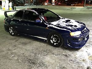 99' Subaru Impreza coupe accepting trades and open to offers
