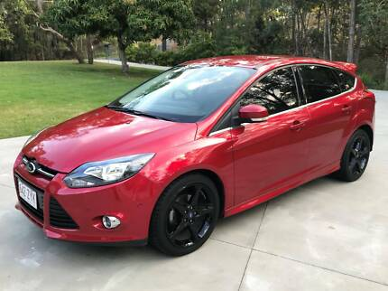 2012 FORD FOCUS TITANIUM. AUTOMATIC, RED 110400 kms.  $9990 Nerang Gold Coast West Preview