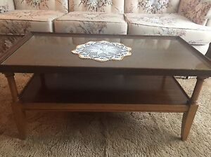 Wooden coffee table with glass top.
