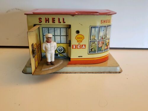 Vintage Mechanical Tin Toy Shell Gas Station  Bank with Key