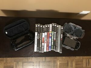 **TWO** PSP Consoles + Games + Movies