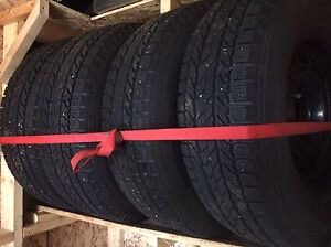Set of 4 BF Goodrich winter tires with rims