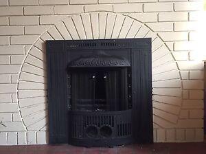 Antique cast iron fireplace screen