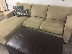 Reversible sectional and leather ottoman.