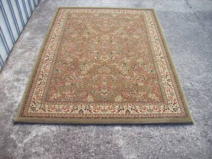 persian style rug 120 cm by 170 cm top quality as new