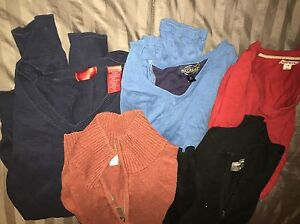 5 sweaters and 3 collared shirts