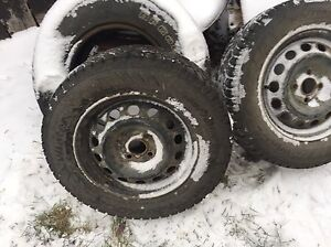 Two 185/70r14 studded winter tires