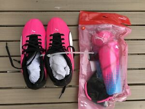 Brand new Puma Girl Soccer Cleats (Size 4.5) and Shin Guard